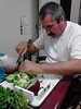 "Title: Carne asada tacos coming this way!""<br /> Caption: This serious-minded gentleman is preparing the vegetables for making tacos, while in therapy, working on improving eye-hand coordination, sequencing steps of a task, and making a favorite meal at Edgemoor.<br /> Photographer: Patty Noerbaek, Edgemoor DP/SNF"