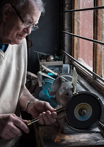 Woodworker sharpening his tools