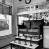 Barbar Shop and Shoe Shine Stand<br /> By Wilfred Smith<br /> 2nd Place<br /> Large Monochrome