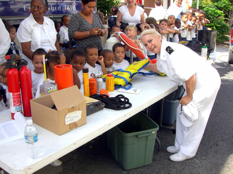 St. Croix USVI's squadron commander teaches young school children about boating safety equipment.