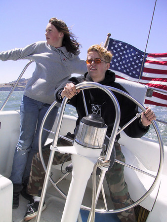 A family member takes the wheel on San Francisco Bay.