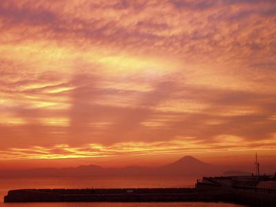 Fuji at sunset on Sagami Bay near Tokyo.