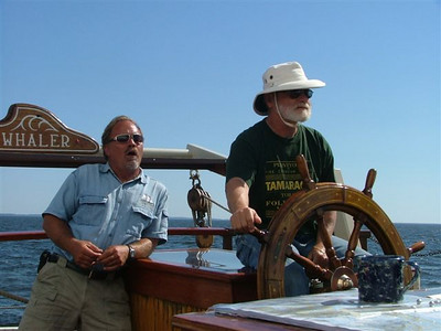 At the helm of the Mystic Whaler
