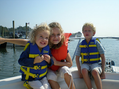 Three grandchildren on my Boston Whaler