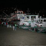 Boaters tied to the levee enjoy a car show, a Halloween lighted boat parade and fireworks