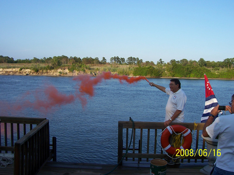 Commander demonstrates smoke signal use