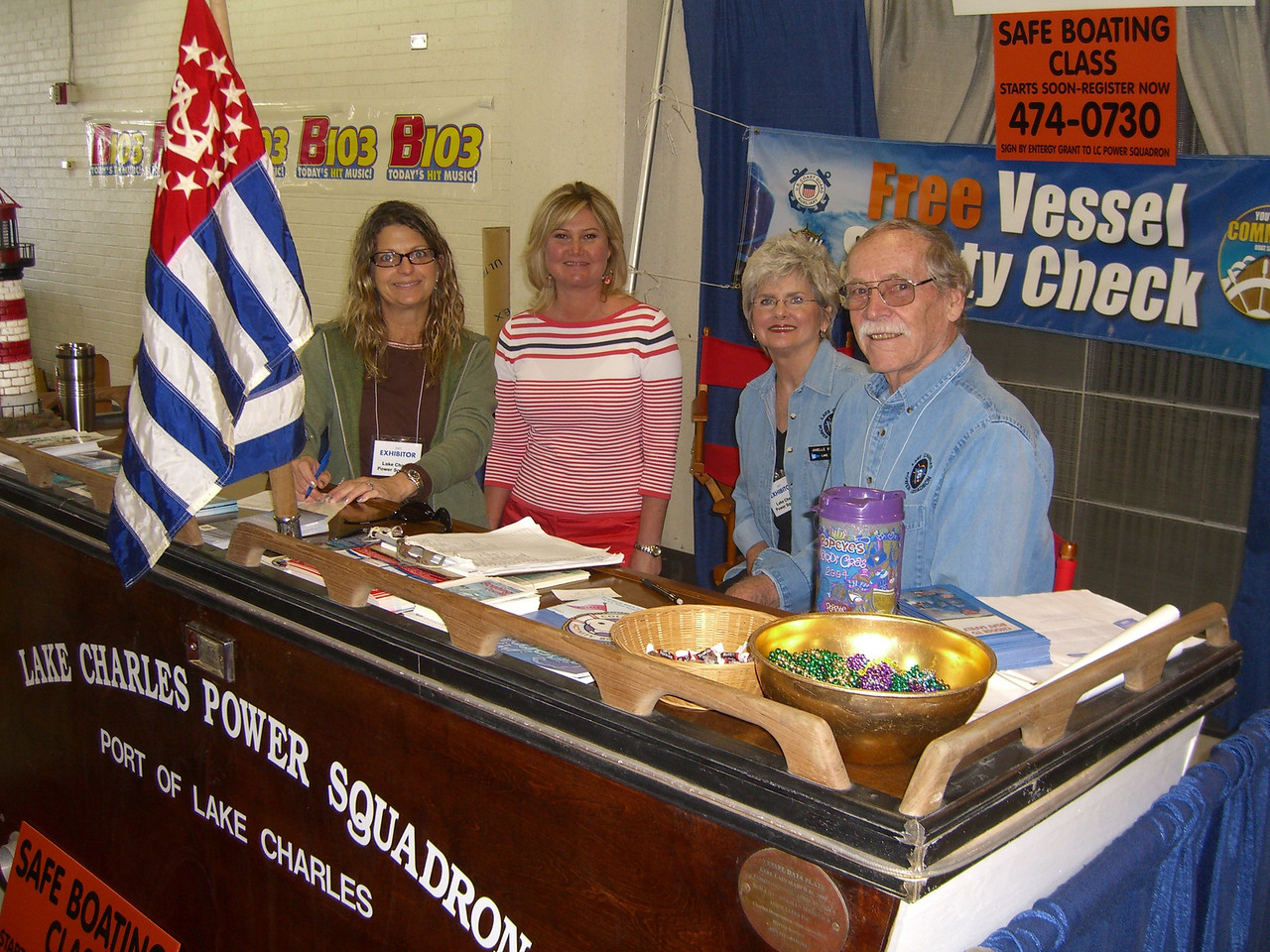 Squadron members work the boat show booth