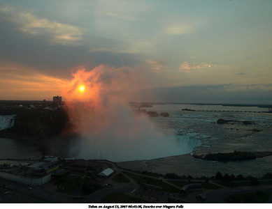 24. Sunrise over Niagara Falls, by Michael Meissner. Shot with an Olympus E-510, 14-54mm lens, tripod, polarizer, shot through window, f/8.0, ISO 100, 1/15 sec, 14.0mm, aperture priority, natural color, spot metering, bias -1.0. Taken on August 15, 2007 06:45:56 in Niagara Falls, Ontario, Canada
