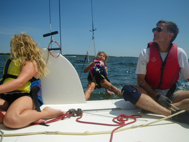 The kids  love trapezing on the side of our catamaran!