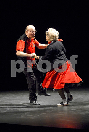 "-Messenger photo by Hans Madsen<br /> <br /> Harold Oleson and Linda Gallea kick off the evening with a dance to the 1950's classic ""Rock Around the Clock"" Saturday night at the Dancing with the Stars Fort Dodge fundraiser."