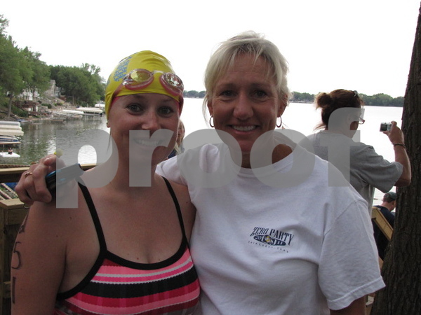 Brittany Bush with her supporter, Colleen Miederhauser, before the triathlon began.