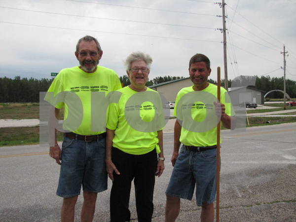 Chuck and Caroline Sayre, and Tim Huser were volunteers directing traffic and athletes at the Twin Lakes Triathlon.