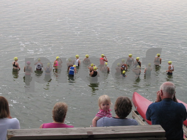 The first round of swimmers assemble in the lake.