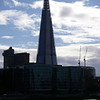 Buildings. London's ever-changing skyline. The Shard emerging on the south bank of the Thames near Tower Bridge.