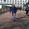Humour. A street shot from Green Park. I was a few seconds too late on the draw with my blackberry for this one really, but look carefully and you will see a ferret being taken for a walk, wearing a santa hat!