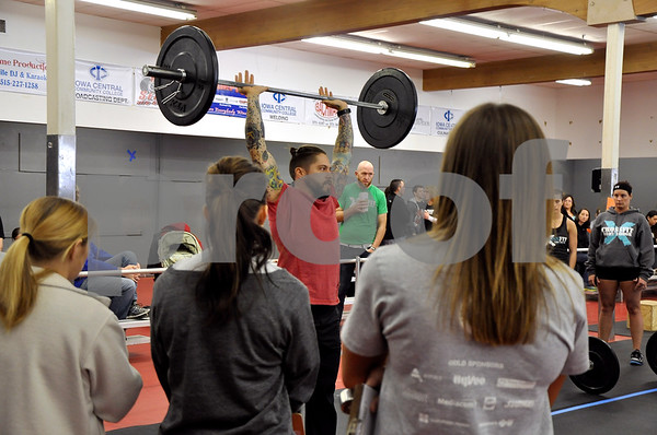 "-Messenger photo by Joe Sutter<br /> <br /> Head Judge JD Alex, of Des Moines, instructs the athletes how exactly to complete the ""thrusters"" station in the second workout set."