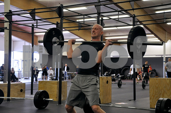 -Messenger photo by Joe Sutter<br /> <br /> After tiring himself out with four other challenges, Nicholas Webb, of Des Moines, does lunges with 135 lbs of weight as the last event in the first set of workouts. Webb already completed a 1,000 meter row, 30 clean lifts, 25 sets of toes to bar, and 20 deadlifts before reaching this challenge.