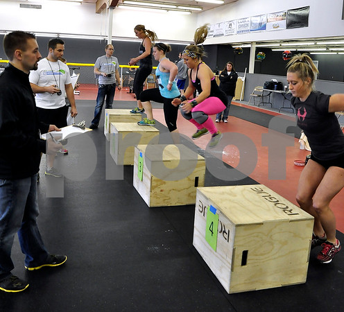 -Messenger photo by Joe Sutter<br /> <br /> Sheena Laughlin, of Des Moines, completes box jumps during the second workout period at the Iowa Gladiator Games Saturday afternoon at the REC Coliseum.