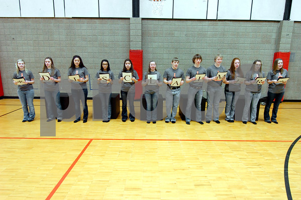 "-Messenger photo by Hans Madsen<br /> <br /> Students from Southeast Webster-Grand give their Readers Theater performance ""Ode to School Lunch"" a final run through Saturday morning during the District Large Group Speech Contest at Fort Dodge Senior High School."