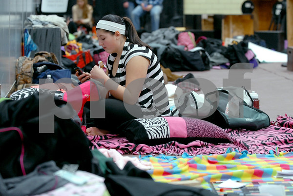 -Messenger photo by Hans Madsen<br /> <br /> KaLee Hansen, 15, of Manning, relaxes among a collection of pillows, blankets and props in the gym during the District Large Group Speech Contest at Fort Dodge Senior High School.