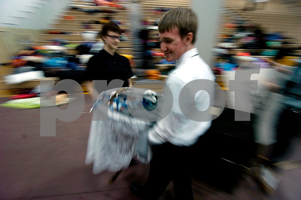 "-Messenger photo by Hans Madsen<br /> <br /> Emily Shook, 16, left, and her classmate Bryce Widel, 15, of Carroll, become a blur of motion as they carry a table back into the gym following their classes One Act Play performance at the District Large Group Speech Contest at Fort Dodge Senior High School. The group performed ""How to Kiss a Girl""."