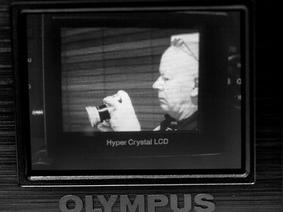 Title: On screen scene User: Madmax40 Details of image: Took picture with E-330 of me holding C-750. Then took shot of 330 screen with the 750. Finally, took shot of 750 screen with the 330. Converted to B/W because original had a luminous blue cast.