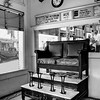 Barber Shop & Shoe shine<br /> By Wilfred Smith<br /> Large Monochrome<br /> Score   11 August 2009