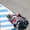 #15 De Angelis of San Carlo Honda Grisini team entering the corkscrew