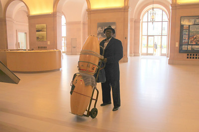 Don Lockett, one of the performers, rolls his drums into the front lobby of the Herbst Theater.