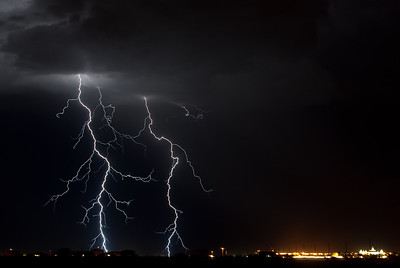 A pair of lightning bolts over the Arizona desert during a summer monsoonPhotographers Name : Scott WoodPhotographers City and State : Chandler AZTo vote in favor for this photo, simply add a comment below. You can also share this photo on Facebook and Twitter using the buttons above.