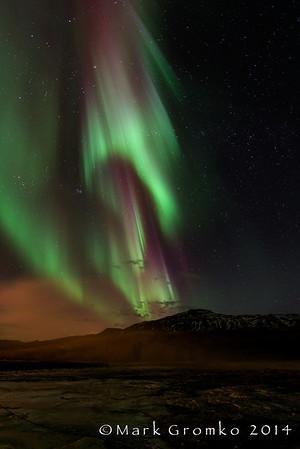 Geyser Steam and Aurora at Geysir Iceland