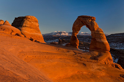 """Sunset Glow on Delicate Arch."" The maximum glow of the red sun on the red rock rises and falls within 10 to 15 minutes just before sunset. (Honorable Mention, Travel Print, N4C April 2012: Honorable Mention, Travel Print, Best of N4C 2012)"