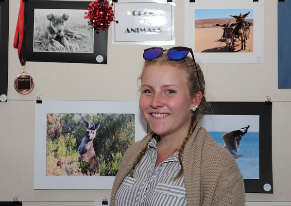 Our 2017 RS.Williams Medal winner Karlie Hearne from Yass with a photo (top left) of her puppy displayed at the Bookham Sheep Show and Fair.