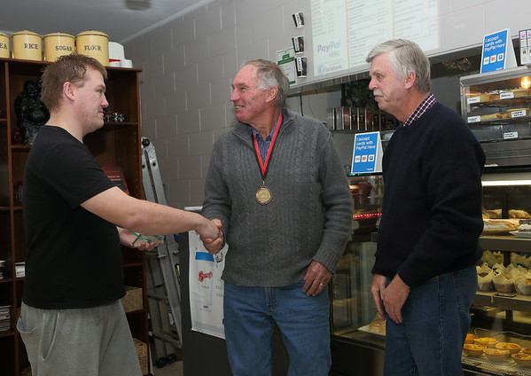 """Major sposor Darryl Dowling of """"Barney's Cafe"""" at Bookham, presents the 2014 RS.Williams Medal to Mr. Geoff Henderson from Binalong. Head steward Mr. Phil Cox of the Photography section at Bookham Sheep Show and Fair looks on."""