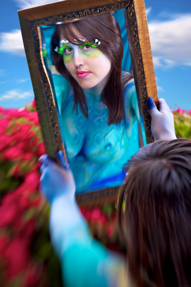 """The Enchanted Mirror<br /> by John Gasca<br /> <br /> 2nd Place in the """"Reflections"""" Saddleback Challenge 2011. <br /> 3rd Place in """"The Next Level"""" community (Very Colorful) competition of Inspire 2011: <a href=""""http://inspi.re/"""">http://inspi.re/</a><br /> <br /> Model - Veronica Tagami  ......  Lighting Assistant - Mike Uribe  ......  Makeup & Body Paint Artist - Mariposa Curiosa<br /> <br /> Glance into my world, an ocean of color<br /> a palette of hues infused like no other<br /> join me in my garden and you will see<br /> the enchanted mirror with an echo of me<br /> <br /> Details:<br /> This image treatment was created mostly 'in camera' with a Lensbaby Composer Pro to give it a fantasy painterly feel.  Side lighting done with 24"""" softbox strobe (camera left) and bare strobe (camera right).  Makeup and airbrush body paint took almost 2 hours.  For those of you wondering ... the answer is yes.  Veronica is wearing a bikini that was also painted.  It was shot during a 'LIVE' photo shoot demonstration in front of attendees of the Skimtastique art gallery in Venice CA.  Thank you to everyone involved with the project!"""