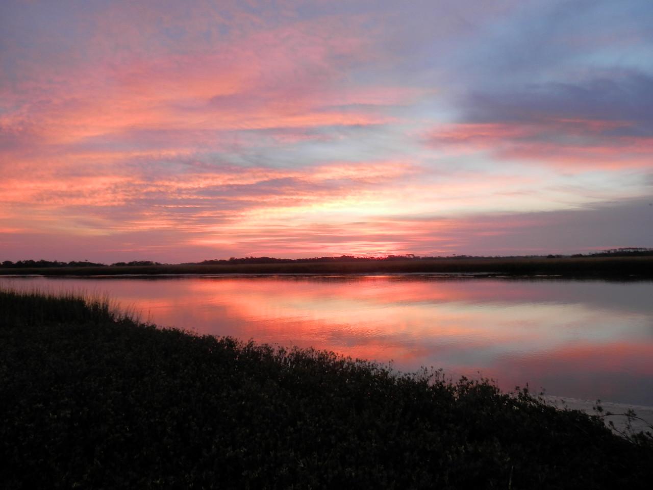 Photo was taken at Day Break looking East over the Bald Head Island Creek. by Captain Beth Schwab.