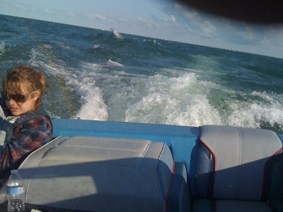 My son, John Vaughn, took this photo while heading for shore from seven miles out of Conneaut Harbor on Lake Erie after an unexpected wind blew in. That is my granddaughter, Jill Burke. The caption is: Hunkered Down for the Ride. Or, Calm Seas Don't Make Skillful Sailors. - Arthur E. Vaughn