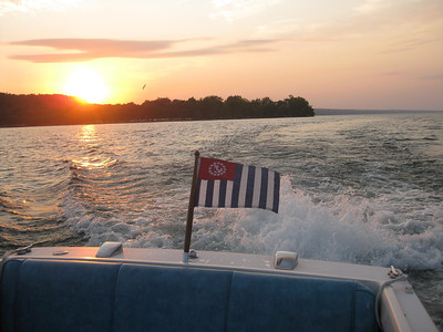 Proudly flying our USPS Ensign as we enjoy a sunset cruise on Cayuga Lake, Ithaca, NY - Mary Kucharek