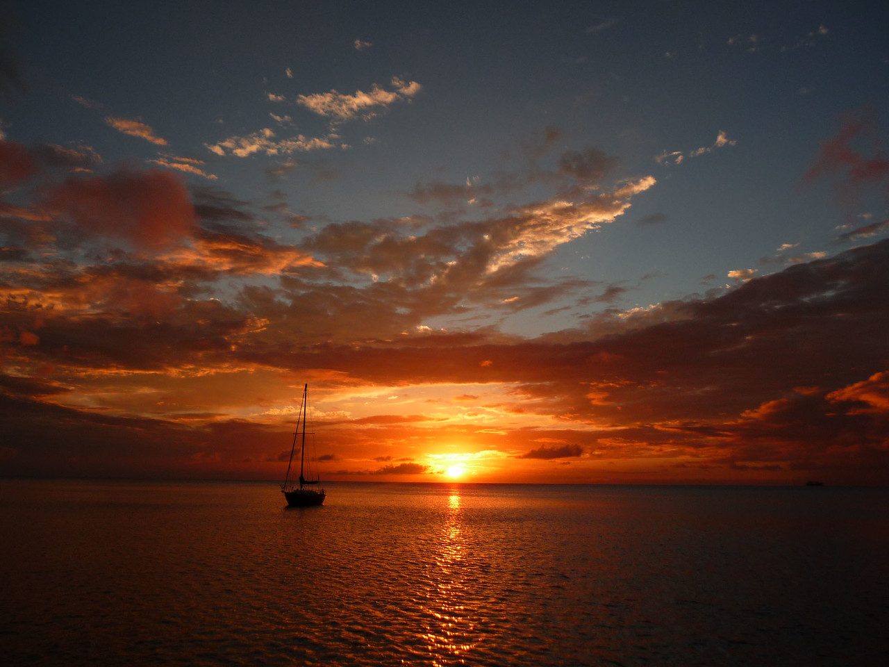 """""""A Gorgeous Sunset"""" while anchored in in the lee of the Island of Nevis. 2011 - Thomas R. Hefty, Jr"""