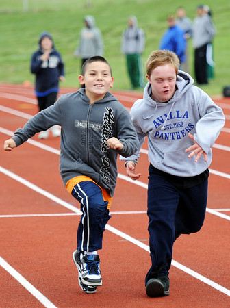 Alex C. Colston, left, 9, of Neosho, and Austin J. Liberty-Ackerson, 12, of Avilla, compete in the 50-meter Friday morning, April 20, 2012, at MSSU's Fred G. Hughes Field. Globe/T. Rob Brown