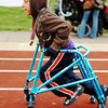 Isaac Ramirez, 11, of Sarcoxie, competes in the 20-meter assisted walk during the Special Olympics Friday morning, April 20, 2012, at MSSU's Fred G. Hughes Field. Globe/T. Rob Brown