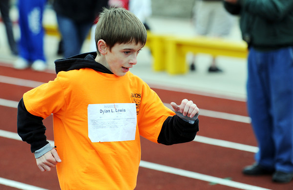 Dylan L. Lewis, 11, of Neosho, competes in the 50-meter during the Special Olympics Friday morning, April 20, 2012, at MSSU's Fred G. Hughes Field. Globe/T. Rob Brown
