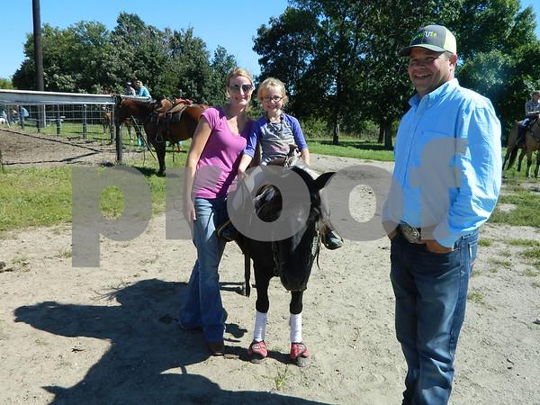 Left to right: Jennifer Conrad, Jada Conrad & Bubbles the horse, and Bub Goings
