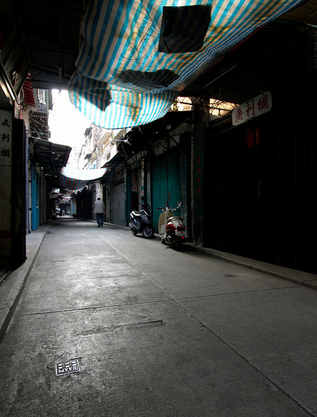 #2 - Johannes - Macau Alley. A quiet alley at Macau (colony of Portugal before 1999, then handed over to China), mid day, the shops are fruits wholesale, mostly closed after they finished business in the morning.