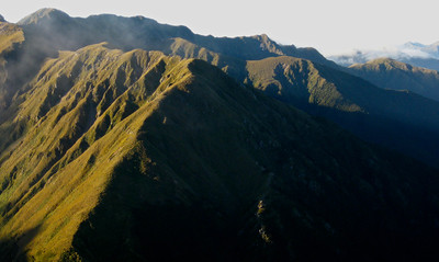 False Spur (Above Bushline) View of the prominently lit False Spur and other more distant ridges, from a southern crossing of the Tararua Range.