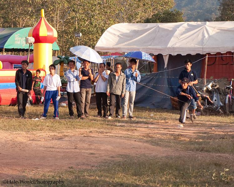Hmong Man Hurling His Top Downfield