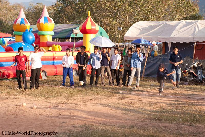 A Hot Game of Tujlub Underway in Luang Prabang, Laos