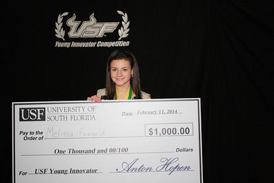 Melissa Feingold holds her award money check