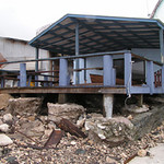 Aftermath of cyclone Meena. Damage to the sea-side of the old Marine Resources building, Cook Islands. Credit: New Zealand Ministry of Foreign Affairs and Trade.