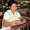 Woman weaving traditional silk cloth to sell, Cambodia. Credit: New Zealand Ministry of Foreign Affairs and Trade